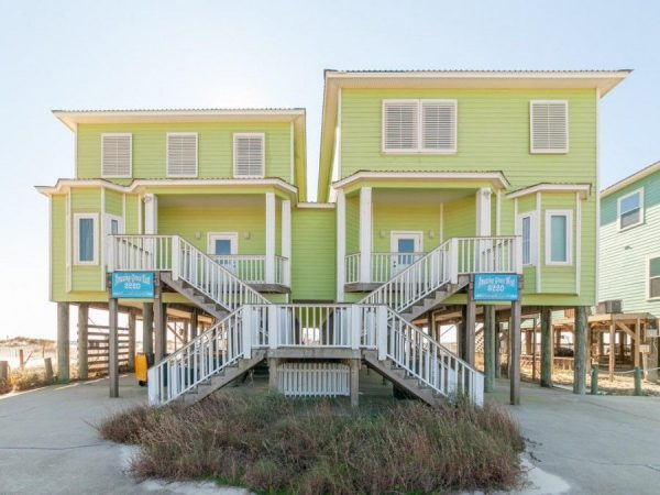 This beachfront vacation rental has a covered deck and a beach walk.