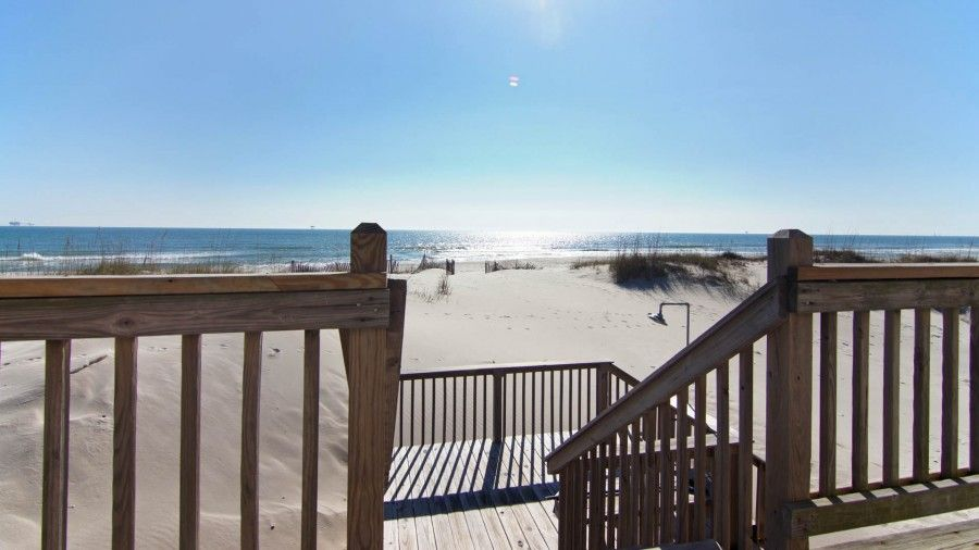 A vacation rental that has a large deck with amazing views of the Gulf of Mexico