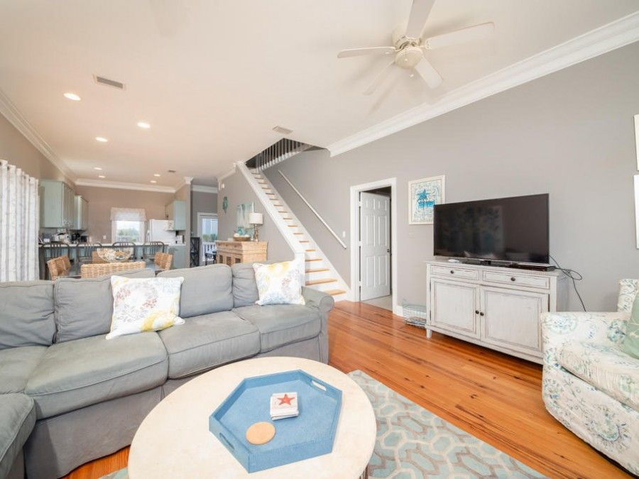 Living room in Gulf Shores vacation rental with pool