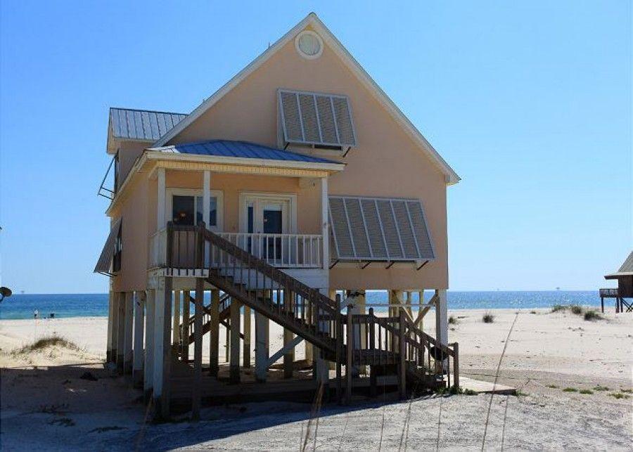 Exterior of peach oceanfront gulf shore beach house.