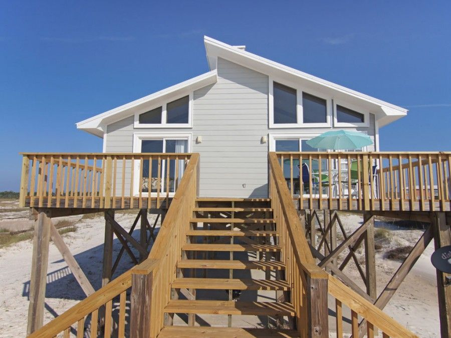 Exterior of gulf shore beach house with full wrap around porch