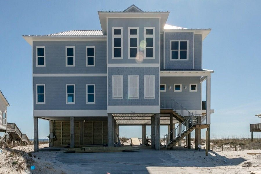 Exterior of multi level blue Gulf Coast beach house
