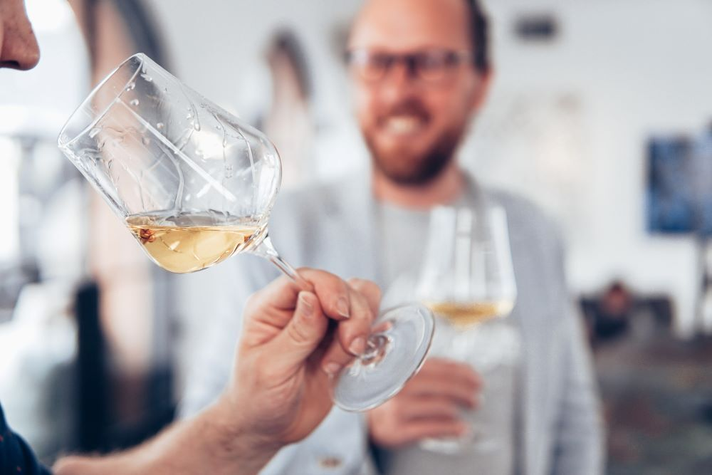 person drinking white wine