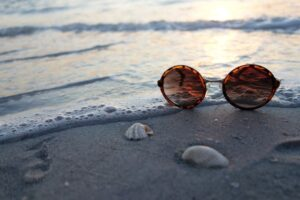 glasses by ocean shore