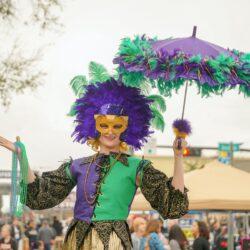 women in a mardi gras parade