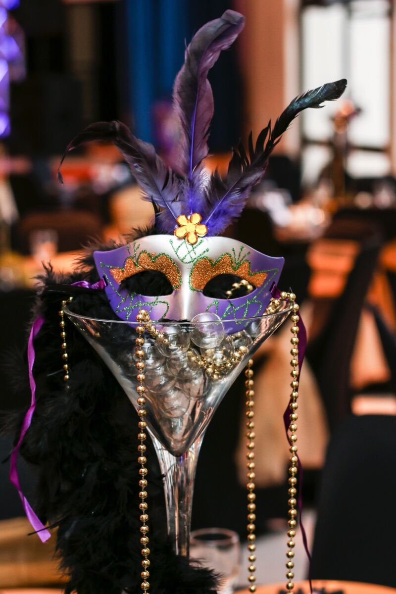 Mardi Gra mask and beads center piece in a glass