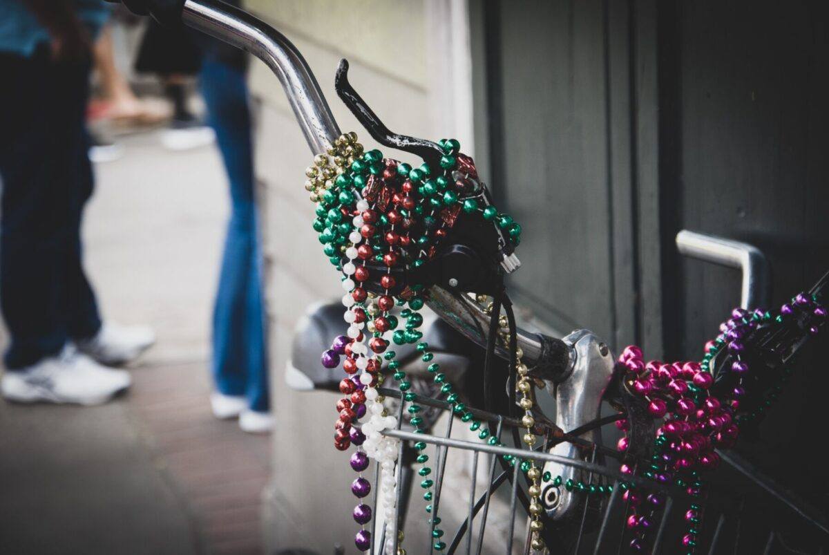 Mardi Gras beads on bicycle handles