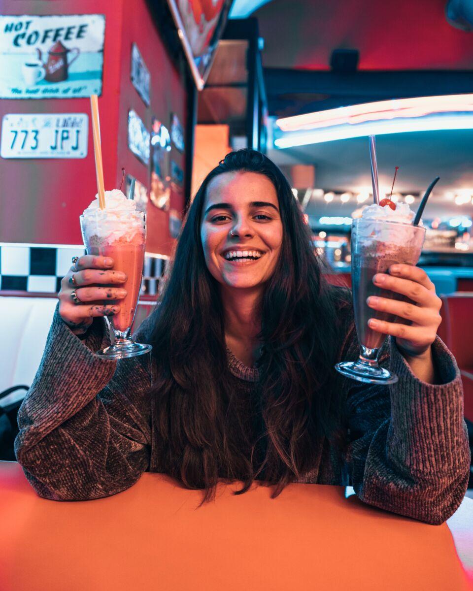 Diner Patron Enjoying Her Milkshakes