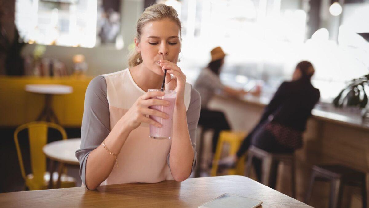 A patron enjoying her milkshake near our Gulf Shores beach rentals