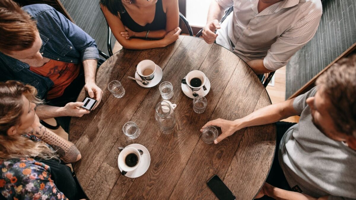 A group of friends enjoying coffee in a coffee shop near our Gulf Shores rentals