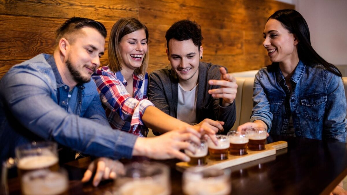 A group of friends enjoying one of the best craft beer places in Gulf Shores