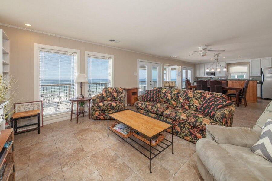 Beautiful living room with beautiful views found in our gulf shores waterfront rentals